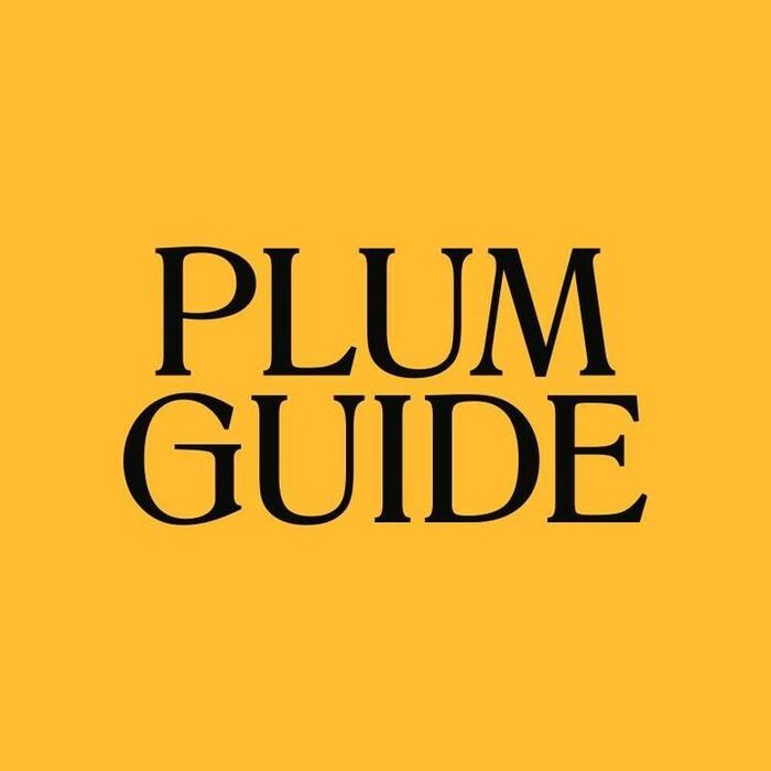 The Plum Guide logotype uses all-caps Romana, customized with an elongated G bar.