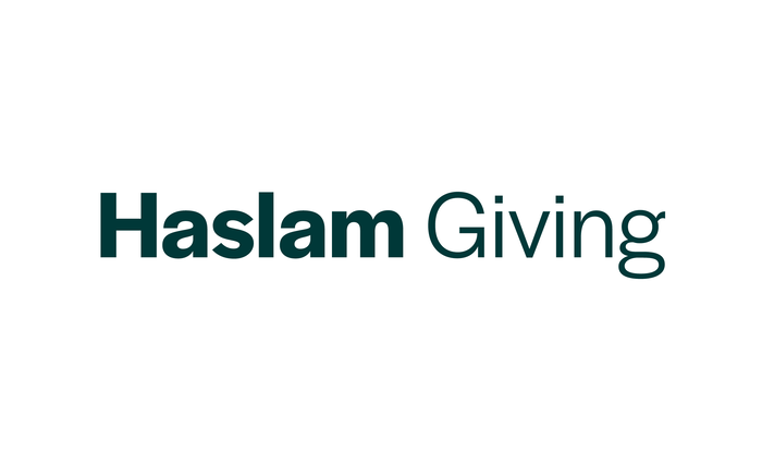 The Haslam Giving wordmark uses two contrasting weights of Halyard Display.