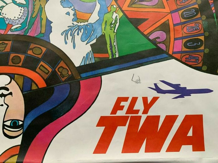 Detail with the Fly TWA logo.
