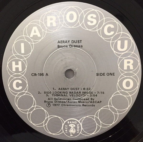 "Aeray Dust record label (1977). Text is set in the Selectric version of . ""Chiaroscuro"" is in caps from Univers Bold."