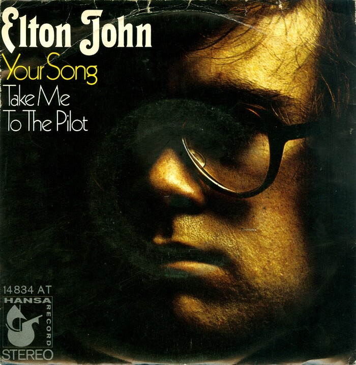"""The German sleeve of """"Your Song"""" – the album's opening track and Elton John's breakthrough single – with B-side """"Take Me To The Pilot"""" uses a detail from Stanford's portrait photograph. Thalia is here paired with  for the titles. The record was released by Hansa Records, 1970."""