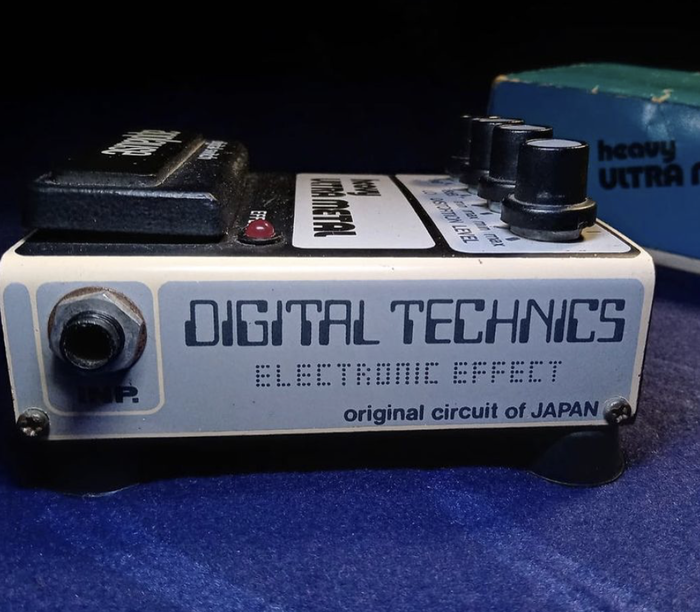 """The -style caps for """"Digital Technics"""" and the dot-matrix letters for """"Electronic Effect"""" are unidentified. Regarding the former,  (2001) has a similar C, but is different in other details. Chances are it's a custom-drawn logo."""