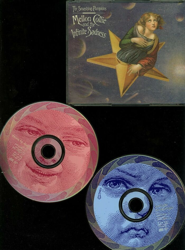 Front cover and tops of both CDs in the double CD album.