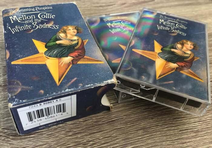 Casette slip cover and two cassette cases.