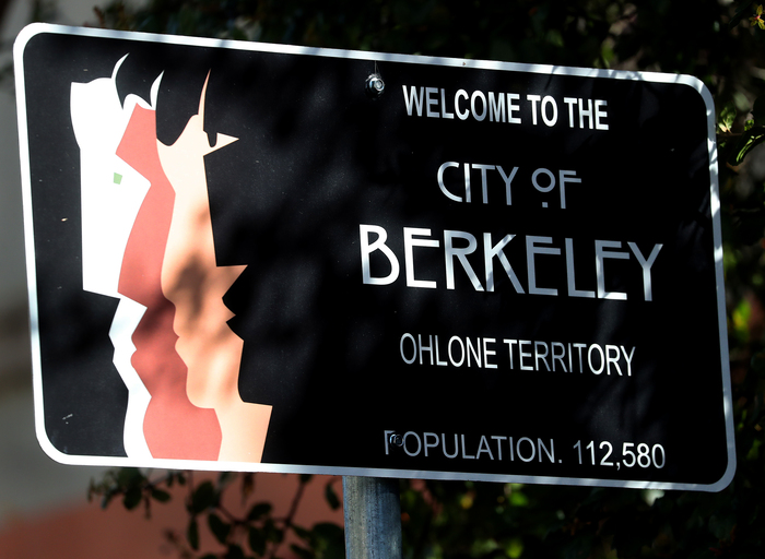 The actual implementation of a welcome sign, photographed near the intersection of College and Alcatraz Avenues in March 2019. Secondary text is in .