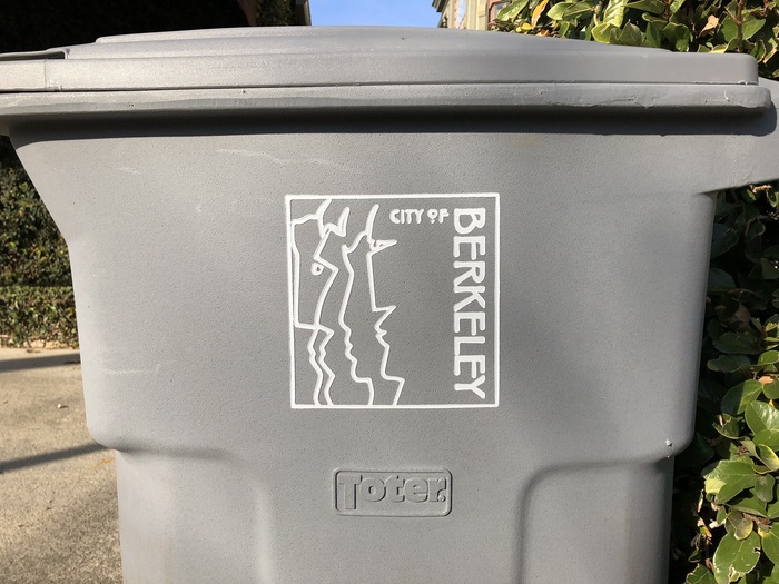 The logo in a routed rendition, as seen on a trash bin.