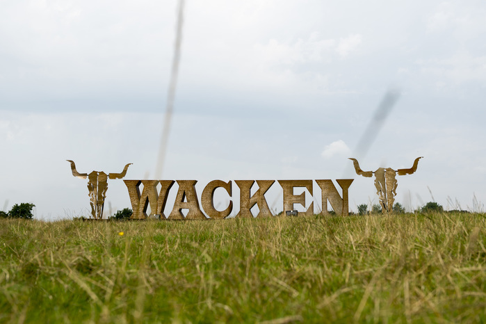 Framed with skulls, the giant Wacken logo made of steel welcomes the visitors at the festival venue.