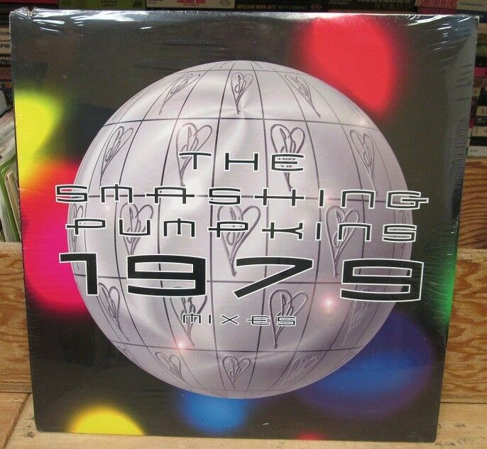"""Front cover of the vinyl release of the """"1979"""" mixes, featuring a globe (or disco ball) with the SP heart logo."""