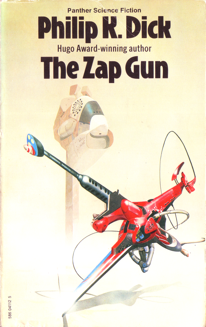 """The Zap Gun (1975). Cover art by Peter Andrew Jones. [More info on ISFDB]    The typeface used for """"Hugo Award-winning author"""" between 1975 and 1980 is a version of  Condensed. It sometimes appears with the standard double-storey g, sometimes with a single-storey form, and occasionally with both, in changing positions. I wonder whether this was some sort of running gag among the typesetters."""