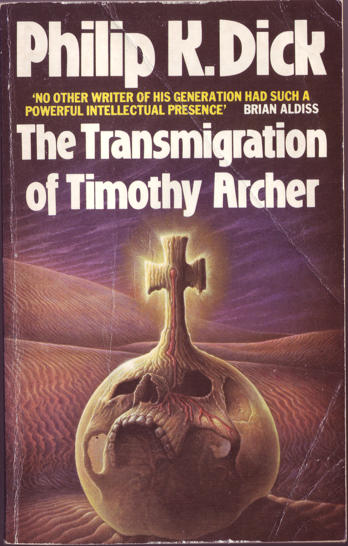 The Transmigration of Timothy Archer (1983). Cover art by by George Underwood. [More info on ISFDB]  The secondary typeface here is all-caps .