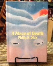 <cite>A Maze of Death</cite> by Philip K. Dick (Doubleday, 1970)