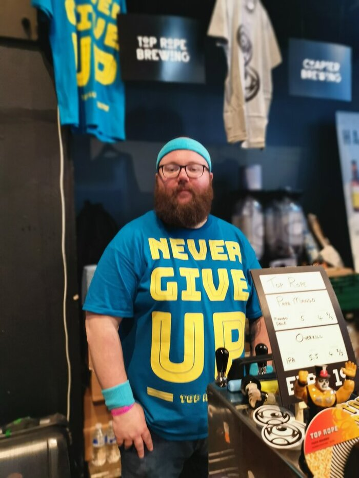"""""""Never Give Up"""" T-shirt."""