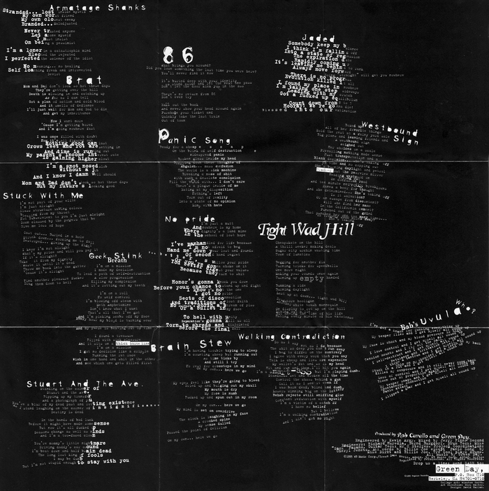 Back side of the folded cover poster, with the lyrics set in two weights from FF Trixie. Titles are in Canadian Photographer, Canadian Photographer Script, and a scratched style that's unidentified and possibly custom.