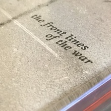 <cite>The Front Lines of the War</cite> album art
