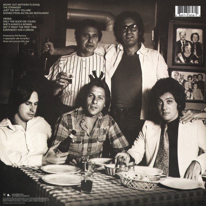 """Back cover, re-issue from 2008. From Wikipedia:   The photograph on the back cover of the album, featuring Joel, Ramone (donning a Yankees shirt at the time of the picture) and each of the band members, was taken at the Supreme Macaroni Company, one of several restaurants where the group would go to """"have these crazy lunches and dinners."""""""