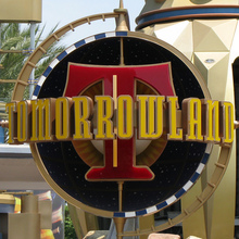Tomorrowland signs at Disneyland Park and Magic Kingdom