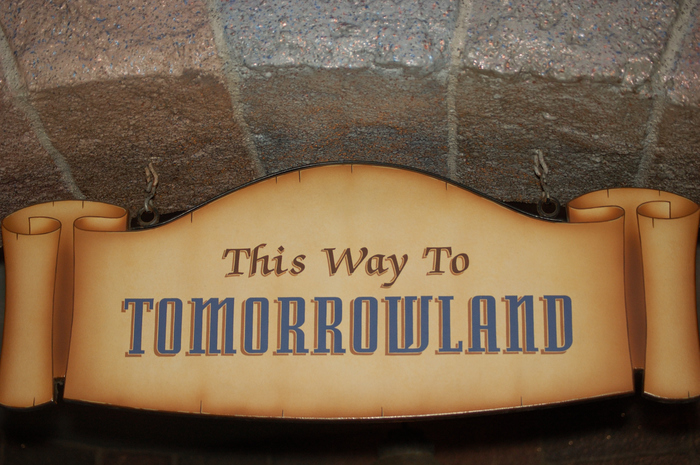 Tomorrowland signage at Disneyland Park and Magic Kingdom 6