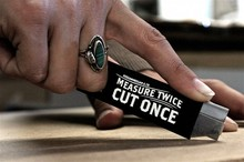 """Measure Twice, Cut Once"" box cutter"