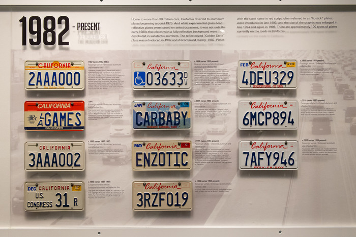 "A panel at the Peterson Automotive Museum: ""The scripted red 'California' was introduced in 1993 and went through three different type sizes, starting with this comparatively small script and settling, in about 1997, to the large script which is seen on plates today."""