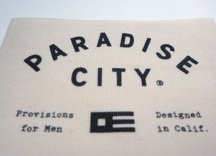 The design for the Paradise City logo took inspiration from international maritime signal flags. The emblem is comprised of the