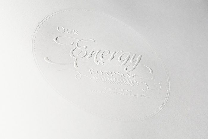 Page 1 of the Commemorative Book is a fly sheet with a white-on-white foil emboss stamp.