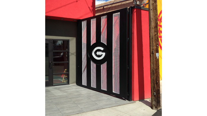 The 9'x10' entry screen combines the referee stripes and the stand-alone 'G', which is the tertiary branding element.