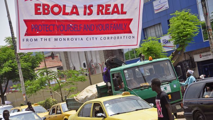 "A banner reading, ""Ebola is real. Protect yourself and your family"" warns people of the Ebola virus in Monrovia, Liberia, on Aug. 2."