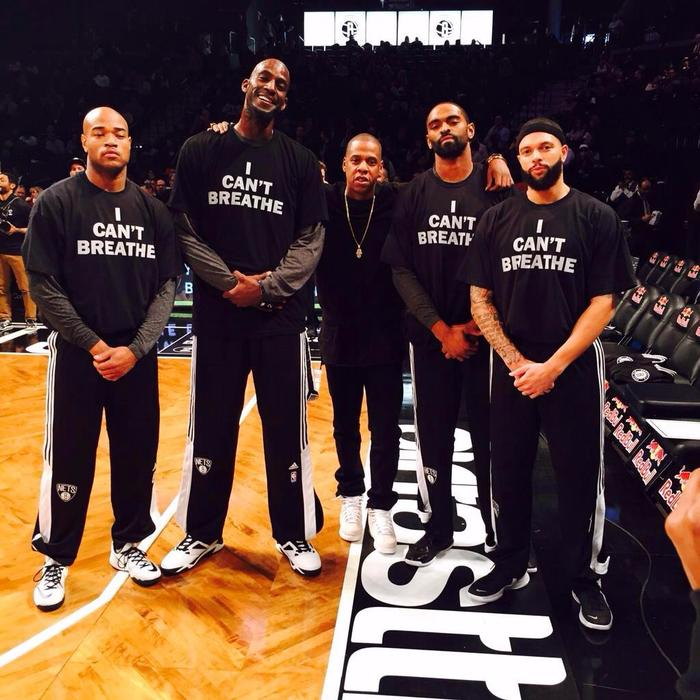 Jarrett Jack, Alan Anderson, Deron Williams and Kevin Garnett of the Brooklyn Nets also wore shirts with this message, albeit rendered in a different typeface (probably Franklin Gothic).