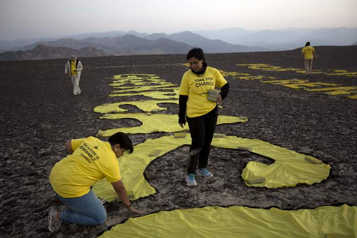 """Time for Change! The Future is Renewable"" Greenpeace message in Nazca, Peru 1"
