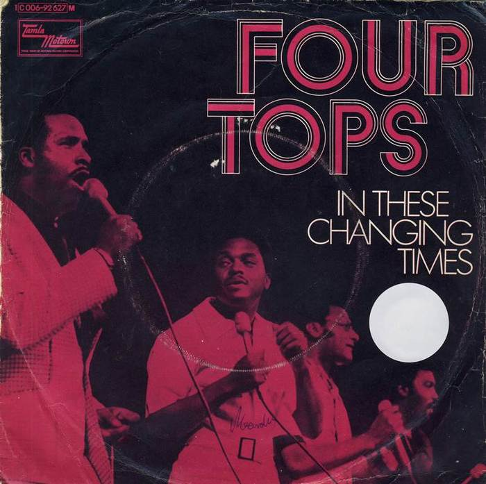 """In These Changing Times"" / ""Right Before My Eyes"", July 1971. Light Futura caps are used for the title."