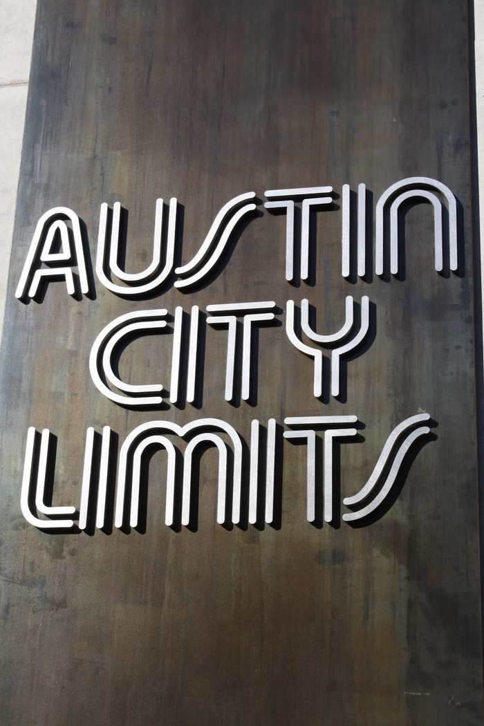 This placard is near the outdoor stairsteps that lead up to the Moody Theater in Austin, Texas.