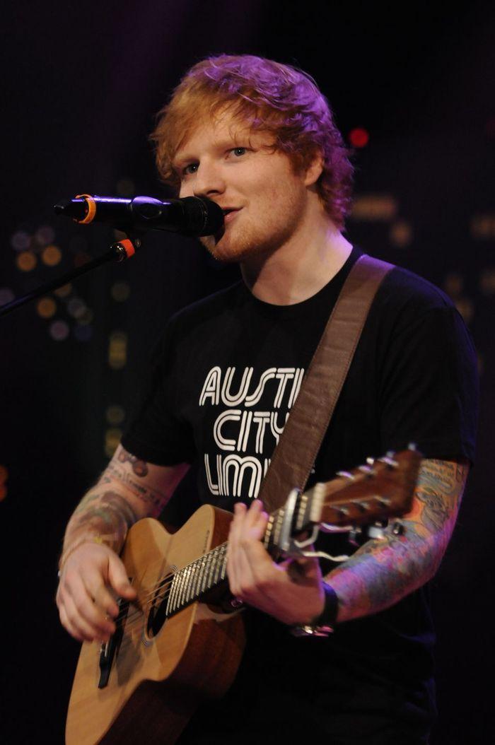 Singer Ed Sheeran performing at Austin City Limits while wearing an ACL shirt.