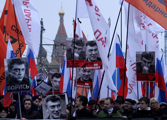 Russian opposition supporters carry photos of Boris Nemtsov in Moscow
