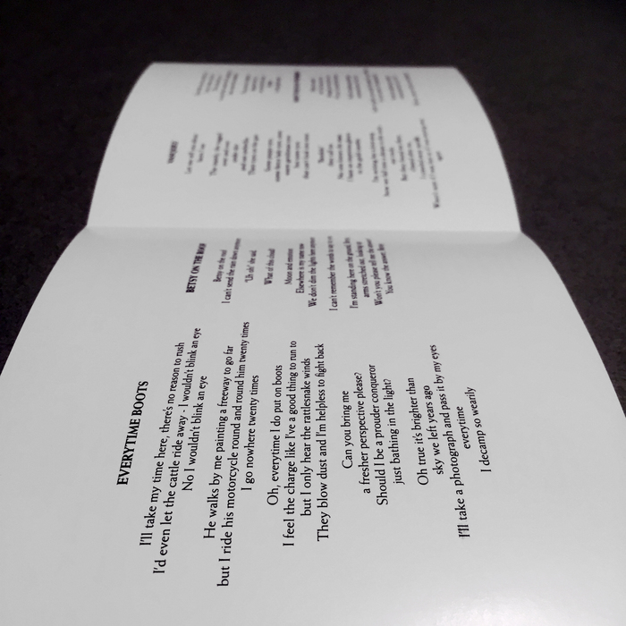 Inside the liner notes. Lyrics and song titles set in Weiss.