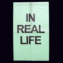 <cite>In Real Life</cite> newsprint / website