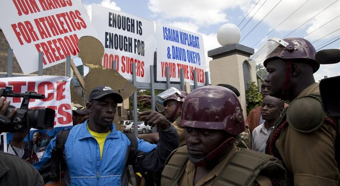 Kenya police stand outside the Kenya Athletic offices in Nairobi, Kenya, Monday, Nov. 23, 2015. A group of Kenyan athletes occupied the headquarters of the national track and field federation on Monday, demanding the removal of its top officials in a protest against doping and corruption.