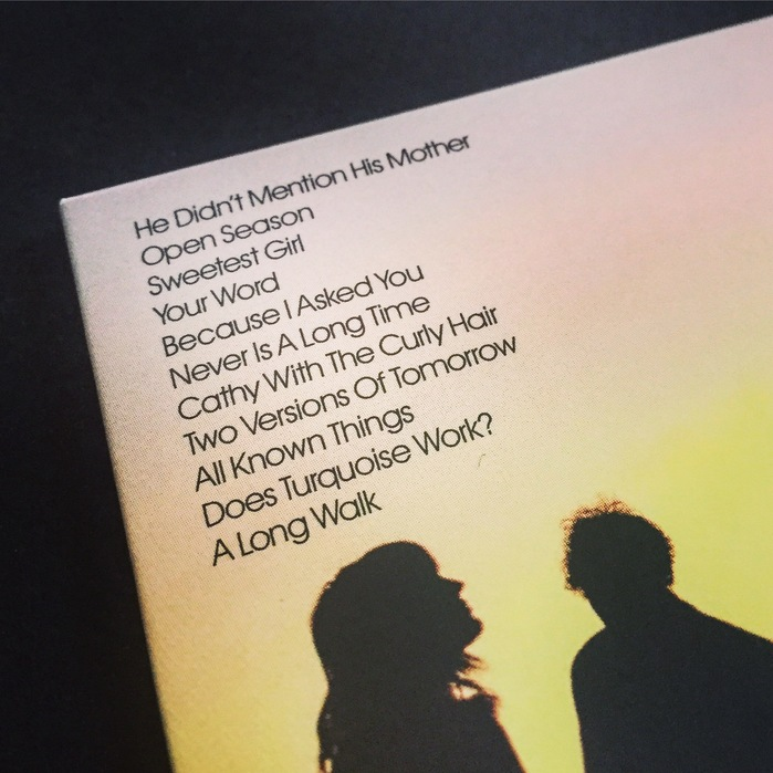 A close-up of the back cover, the upper-left corner features song titles set in ITC Avant Garde Gothic.