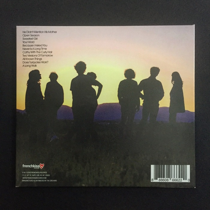 The back cover, with a sunset casting the band in silhouette.