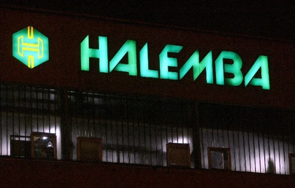 The now vanished sign at the office building, illuminated at night (c. 2006).