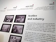 <cite>At The Seams</cite> exhibition