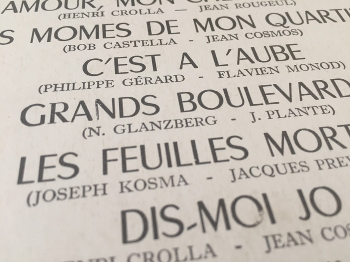 "Song titles set in Chambord, with an accidental serif R in ""Grands"". Names of authors/composers in Caslon?"