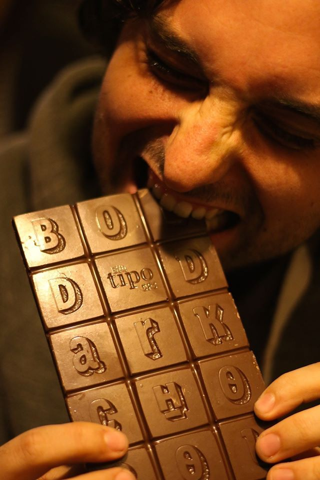 Diego Maldonado eating the official conference chocolate with his typeface, Sorvettero.