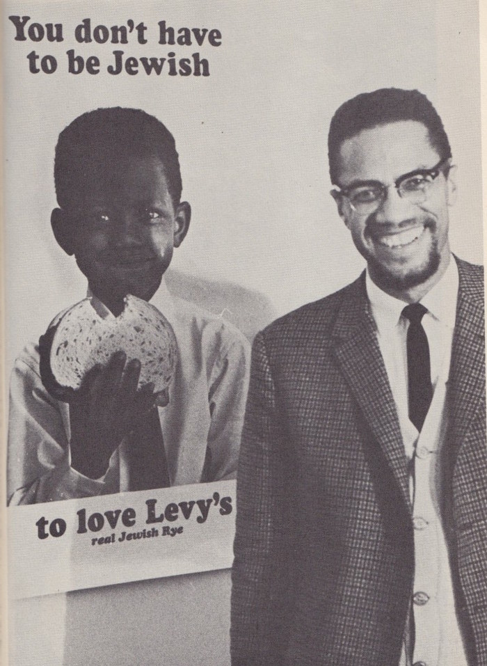 """""""Malcolm X liked the poster featuring the black child so much that he had himself photographed alongside it."""" — The New York Times"""
