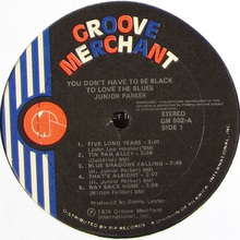 Groove Merchant logo and record labeling