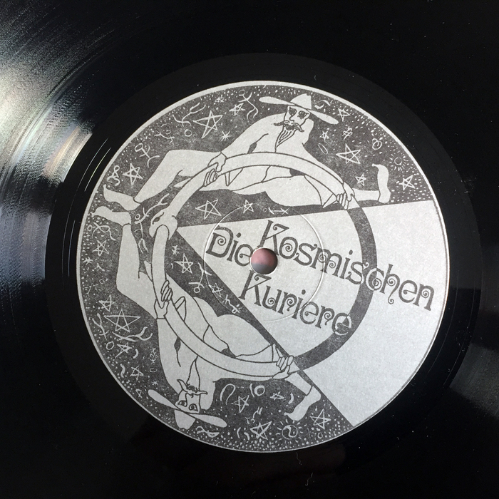 "Record label on the B side, showing two Kosmische Kuriere set in Ringlet. on the back of the record sleeve, the Kuriere are translated to English as ""Cosmic Couriers"" and ""Cosmic Couriers Production""."