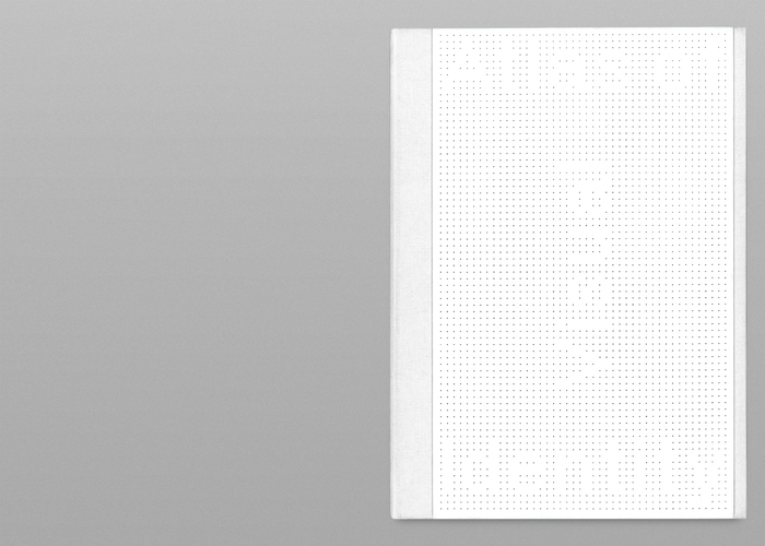 The invisible title, set in Px Grotesk Screen, has been achieved laser cutting holes out of a PVC plate.