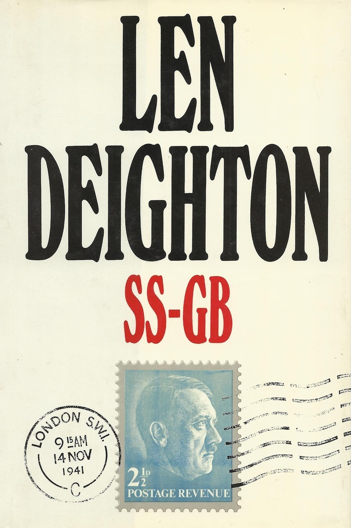 Jonathan Cape, London 1978. Cover design by Raymond Hawkey, with centered caps from Windsor Elongated (and Times New Roman for the stamp).