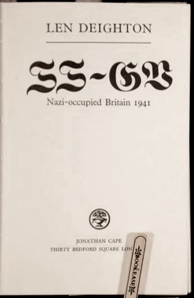 The title page seems to show the letters 'SS-GB' in Fette Fraktur, but what we actually are looking at is a fantasy 'S' (presumably built from other glyph parts), a modified 'G' (with the top right borrowed from 'E'), and the letter 'V' standing in for 'B'. The real fraktur thing was apparently deemed too difficult to decipher for the English readership.