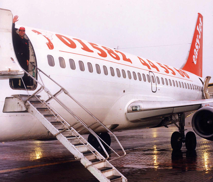 Founder and owner Stelios Haji-Ioannou on the first easyJet flight from Luton to Glasgow, Nov. 10, 1995.