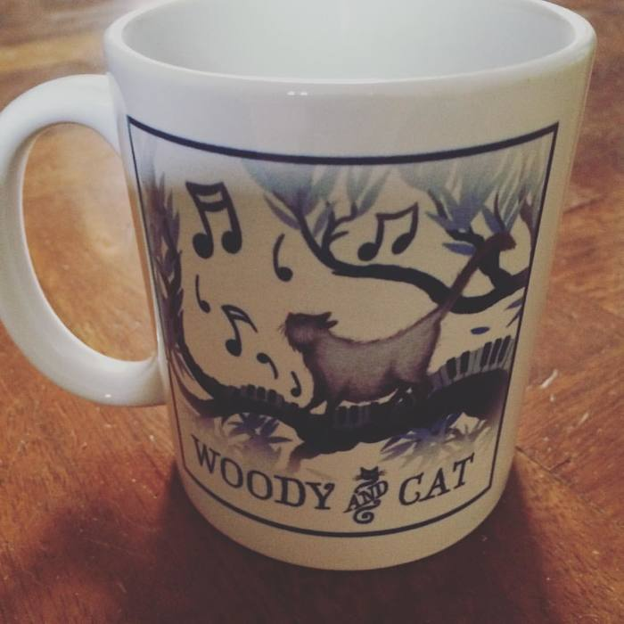 The Woody & Cat coffee mug features Salmiak, too.